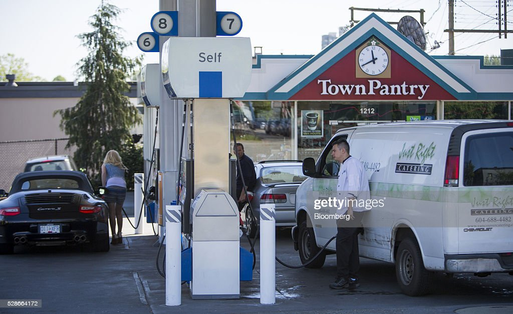 Drivers fill cars with fuel at a Chevron Corp. gas station in Vancouver, British Columbia, Canada, on Friday, May 6, 2016. The worst wildfire in Alberta history is boosting Canadian crude prices as oil companies evacuate workers and shut in output. Photographer: Ben Nelms/Bloomberg via Getty Images