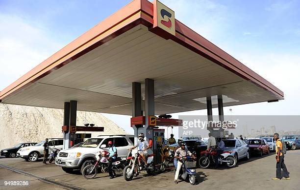 Drivers fill fuel tanks in a gas station in Luanda on December 21 2009 Drivers come at a rate of 1500 a day pumping 65000 litres of gasoline said...