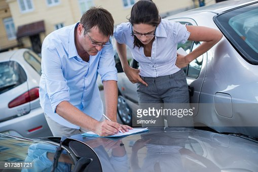 Drivers Fill Out An Accident Report