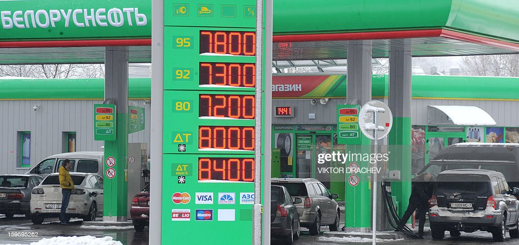 Drivers fuel up their vehicles at a gas station in Minsk, on January 16, 2013.