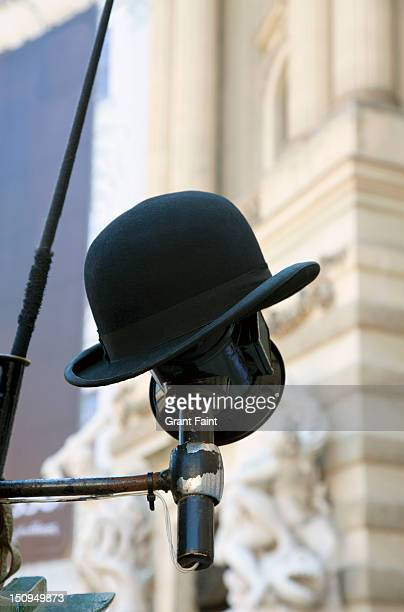 Driver's hat resting on a horse carriage lamp