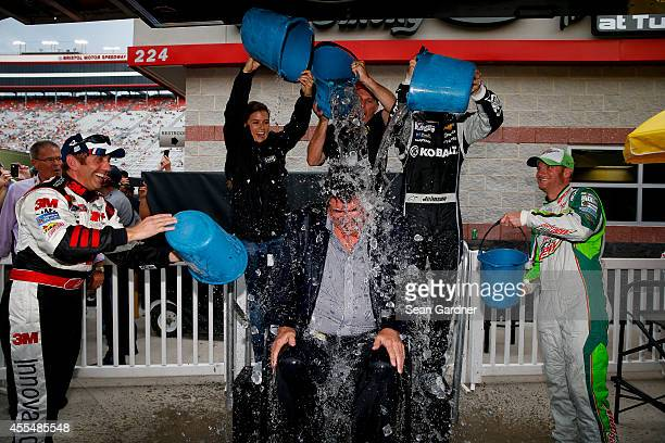 Drivers help NASCAR President Mike Helton participate in the ALS ice bucket challenge during qualifying for the NASCAR Sprint Cup Series Irwin Tools...