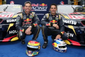 Drivers Jamie Whincup and Craig Lowndes pose during the Red Bull Racing V8 Supercars season launch at the Atrium on February 13 2014 in Sydney...