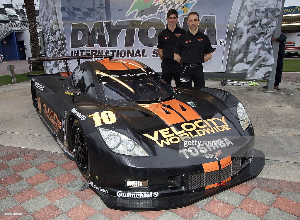 Drivers Jordan Taylor, left, and Max Angelelli pose with the #10 Wayne Taylor Racing Velocity Worldwide Corvette Dallara DP after a press conference announcing Velocity Worldwide as the team's new sponsor at Daytona International Speedway on January 3, 2013 in Daytona Beach, Florida.