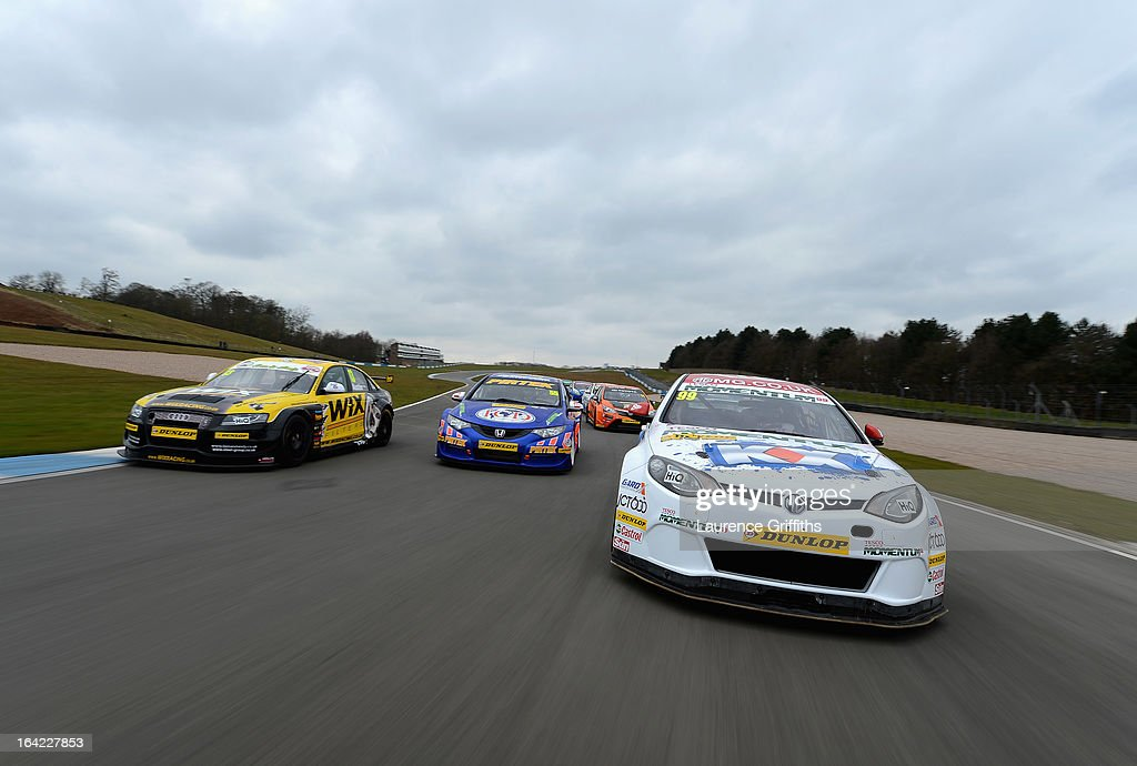 Drivers jostle for position during the BTCC Media Day at Donington Park on March 21, 2013 in Castle Donington, England.