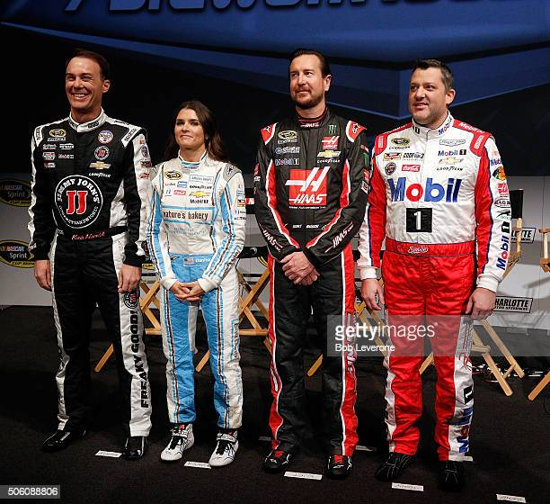 Drivers Kevin Harvick Danica Patrick Kurt Busch and Tony Stewart pose for a photo during the NASCAR 2016 Charlotte Motor Speedway Media Tour on...