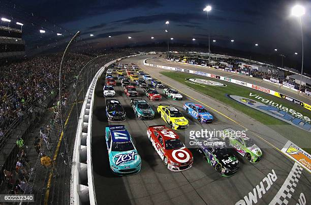 Drivers line up in a fourwide formation to salute fans during the inaugural Fan Appreciation Weekend prior to the start of the NASCAR Sprint Cup...