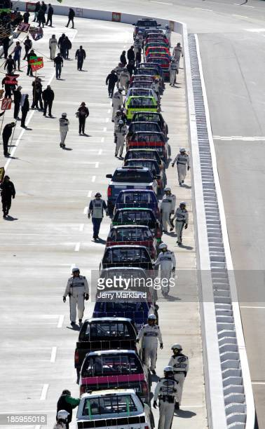 Drivers line up their trucks on pit road prior to the start of the NASCAR Camping World Truck Series Kroger 200 at Martinsville Speedway on October...