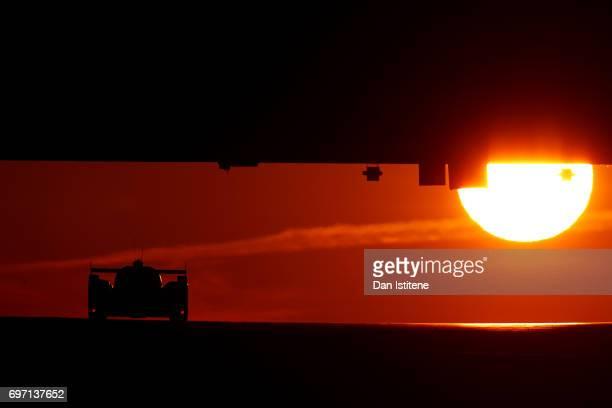 Drivers make their way under Dunlop Bridge a sunrise during the Le Mans 24 Hour Race at Circuit de la Sarthe on June 18 2017 in Le Mans France