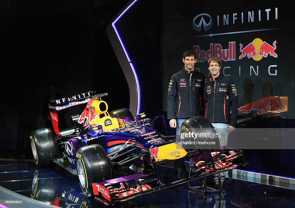 Drivers Mark Webber of Australia (L) and Sebastian Vettel of Germany pose along side the new car during the Infiniti Red Bull Racing RB9 launch on February 3, 2013 in Milton Keyenes, England.