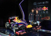 Drivers Mark Webber of Australia and Sebastian Vettel of Germany pose along side the new car during the Infiniti Red Bull Racing RB9 launch on...