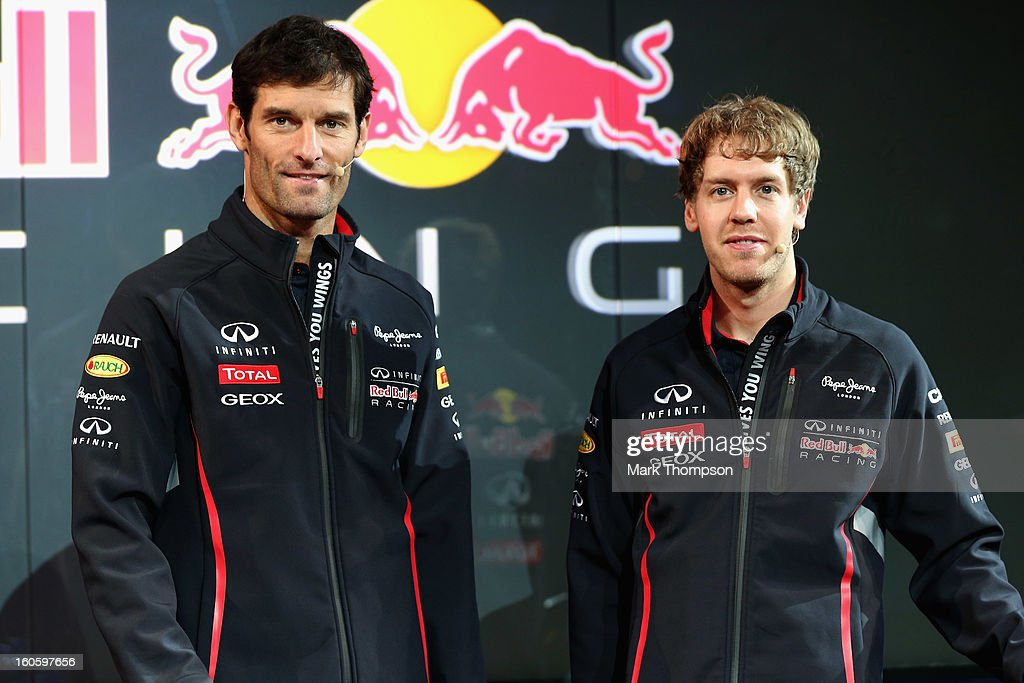 Drivers <a gi-track='captionPersonalityLinkClicked' href=/galleries/search?phrase=Mark+Webber+-+Race+Car+Driver&family=editorial&specificpeople=167271 ng-click='$event.stopPropagation()'>Mark Webber</a> of Australia (L) and <a gi-track='captionPersonalityLinkClicked' href=/galleries/search?phrase=Sebastian+Vettel&family=editorial&specificpeople=2233605 ng-click='$event.stopPropagation()'>Sebastian Vettel</a> of Germany pose during the Infiniti Red Bull Racing RB9 launch on February 3, 2013 in Milton Keyenes, England.
