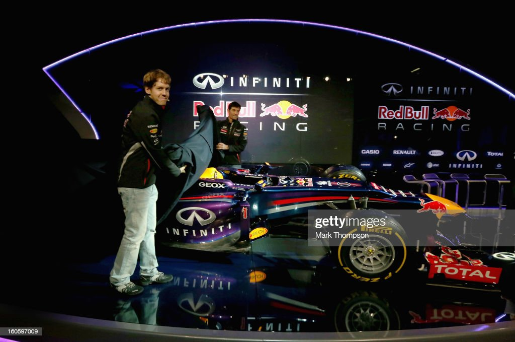 Drivers Mark Webber of Australia and Sebastian Vettel of Germany reveal the new car during the Infiniti Red Bull Racing RB9 launch on February 3, 2013 in Milton Keyenes, England.