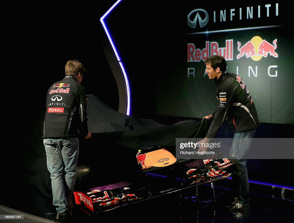 Drivers Mark Webber of Australia and Sebastian Vettel of Germany reveal the new car during the Infiniti Red Bull Racing RB9 launch on February 3, 2013 in Milton Keynes, England.