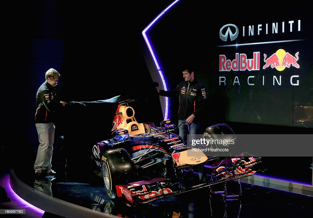Drivers <a gi-track='captionPersonalityLinkClicked' href=/galleries/search?phrase=Mark+Webber+-+Race+Car+Driver&family=editorial&specificpeople=167271 ng-click='$event.stopPropagation()'>Mark Webber</a> of Australia and <a gi-track='captionPersonalityLinkClicked' href=/galleries/search?phrase=Sebastian+Vettel&family=editorial&specificpeople=2233605 ng-click='$event.stopPropagation()'>Sebastian Vettel</a> of Germany reveal the new car during the Infiniti Red Bull Racing RB9 launch on February 3, 2013 in Milton Keynes, England.