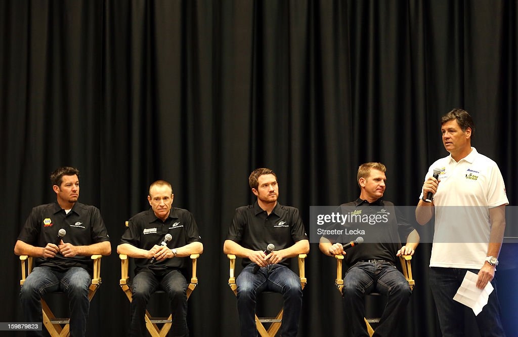 Drivers Martin Truex Jr., Mark Martin, Brian Vickers and Clint Bowyer are introduced to the media by team owner, Michael Waltrip, of MWR Racing during the 2013 NASCAR Sprint Media Tour on January 22, 2013 in Concord, North Carolina.