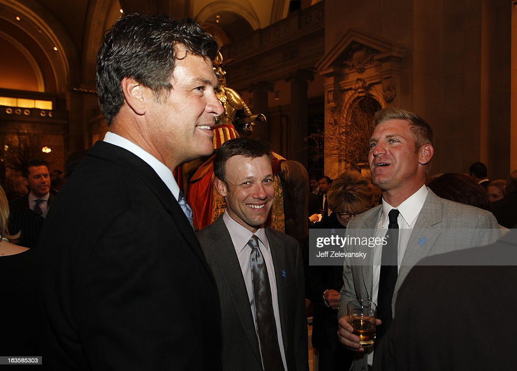 NASCAR drivers Matt Kenseth and Clint Bowyer joke with team owner Michael Waltrip at 'Speeding For A Cure', a gala to benefit Autism Speaks held at the Metropolitan Museum of Art on March 12, 2013 in New York City.