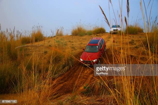 Drivers moves BMW X series cars on off track roads during the BMW xDrive Experience Tour 2017 in Jaipur Rajasthan India on 18 Nov 2017BMW experience...