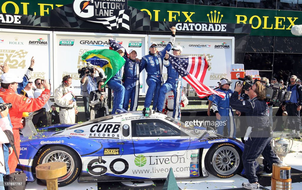 Drivers of the #60 Michael Shank Racing with Curb-Agajanian - Ford Riley celebrate after winning the Rolex 24 at Daytona International Speedway on January 29, 2012 in Daytona Beach, Florida.