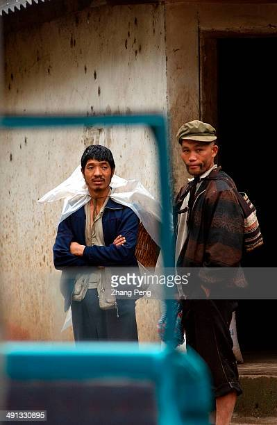 Drivers of the schoolbus waiting for the children to get in The Lisu Autonomous Prefecture of Nujiang located in the northwest of Yunnan province...