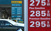 Drivers pass by gas prices that are displayed at Valero and 76 gas stations on February 9 2015 in San Rafael California After weeks of decline in...