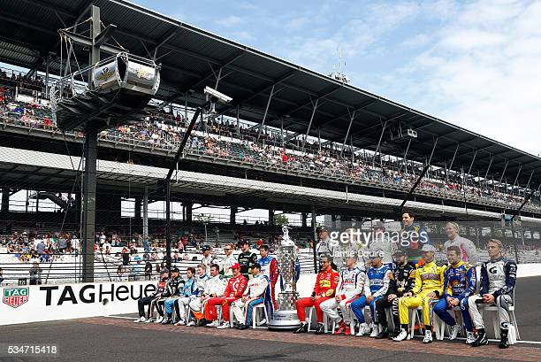Drivers pose on the finish line with the BorgWarner trophy during Carb Day ahead of the 100th running of the Indianapolis 500 at Indianapolis...