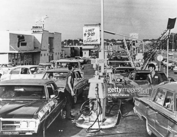 Drivers queue for fuel at a US petrol station during the worldwide fuel shortages caused by the oil embargo imposed by the Organization of Arab...