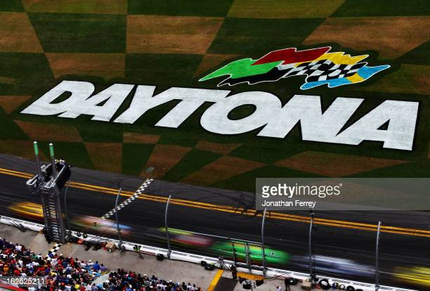 Drivers race during the NASCAR Sprint Cup Series Daytona 500 at Daytona International Speedway on February 24 2013 in Daytona Beach Florida