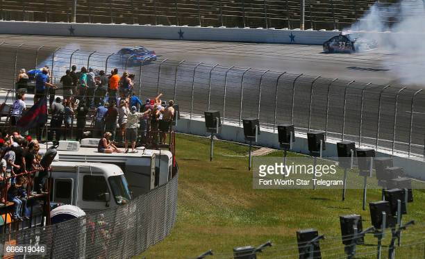 NASCAR drivers Reed Sorenson and Jeffrey Earnhardt spin out exiting turn two during the O'Reilly Auto Parts 500 on Sunday April 9 2017 at Texas Motor...