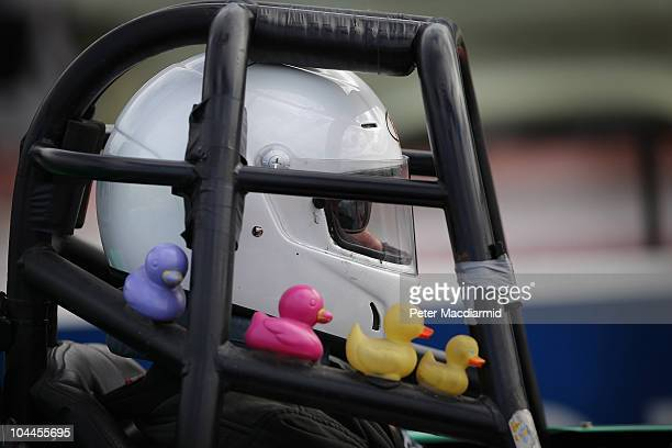 A driver's roll cage is decorated with toy ducks at the Santa Pod Raceway during the National Drag Racing Championships on September 25 2010 in...