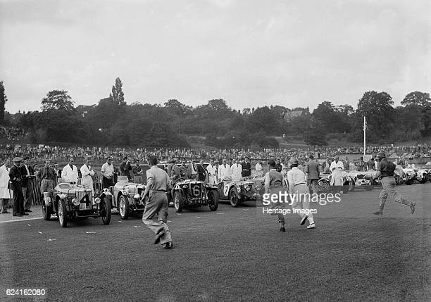 Drivers running to their cars at the start of a race at Crystal Palace London 1939 Artist Bill BrunellMG PB 939S cc Entry No 4 Driver CooperHarewood...