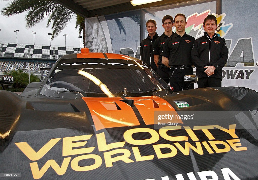 Drivers <a gi-track='captionPersonalityLinkClicked' href=/galleries/search?phrase=Ryan+Hunter-Reay&family=editorial&specificpeople=2197753 ng-click='$event.stopPropagation()'>Ryan Hunter-Reay</a>, Jordan Taylor and Max Angelelli and car onwer Wayne Taylor pose the #10 Wayne Taylor Racing Velocity Worldwide Corvette Dallara DP after a press conference announcing Velocity Worldwide as the team's new sponsor at Daytona International Speedway on January 3, 2013 in Daytona Beach, Florida.