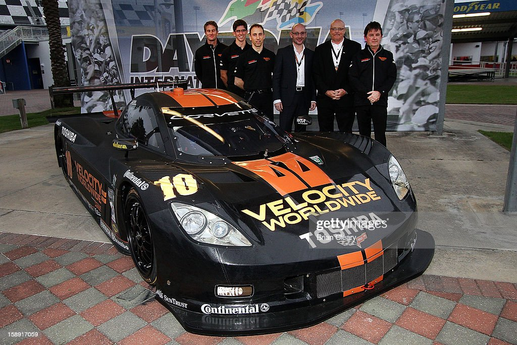 , drivers Ryan Hunter-Reay, Jordan Taylor and Max Angelelli, Velocity Worldwide CEO Americas Paul Blakely, Siemans PLM software VP Jim Menego and car onwer Wayne Taylor pose the #10 Wayne Taylor Racing Velocity Worldwide Corvette Dallara DP after a press conference announcing Velocity Worldwide as the team's new sponsor at Daytona International Speedway on January 3, 2013 in Daytona Beach, Florida.