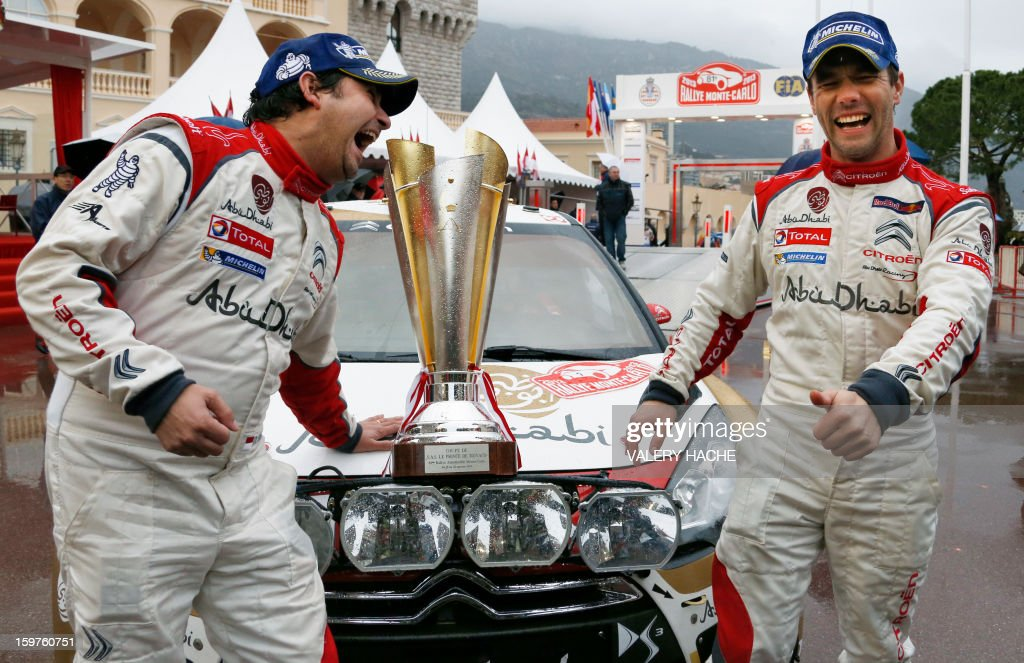 Drivers Sebastien Loeb of France (R) and Daniel Elena of Monaco (L) share a laugh a day after winning the Monte-Carlo rallye race, opening stage of the World Rally Championship, on January 20, 2013 in Monaco. World champion Sebastian Loeb, in a Citroen, clinched a seventh Monte Carlo Rally title after heavy snow and driving rain caused the race's last two stages to be cancelled. AFP PHOTO / VALERY HACHE