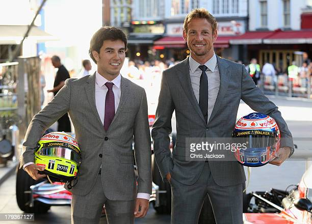 F1 drivers Sergio Perez and Jenson Button attend the Rush World Premiere at Odeon Leicester Square on September 2 2013 in London England