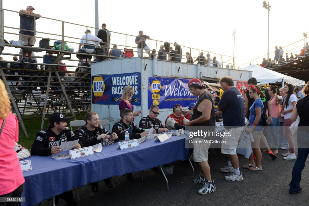 Drivers sign autographs at the Call Before You Dig 811 150 at Stafford Motor Speedway August 8, 2014 in Stafford, Connecticutt.