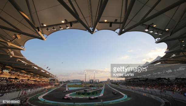 TOPSHOT Drivers steer their cars during the Abu Dhabi Formula One Grand Prix at the Yas Marina circuit on November 26 2017 Valtteri Bottas survived...