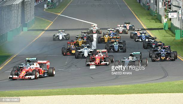 Drivers take the first corner during the start of the Formula One Australian Grand Prix in Melbourne on March 20 2016 / AFP / SAEED KHAN / IMAGE...