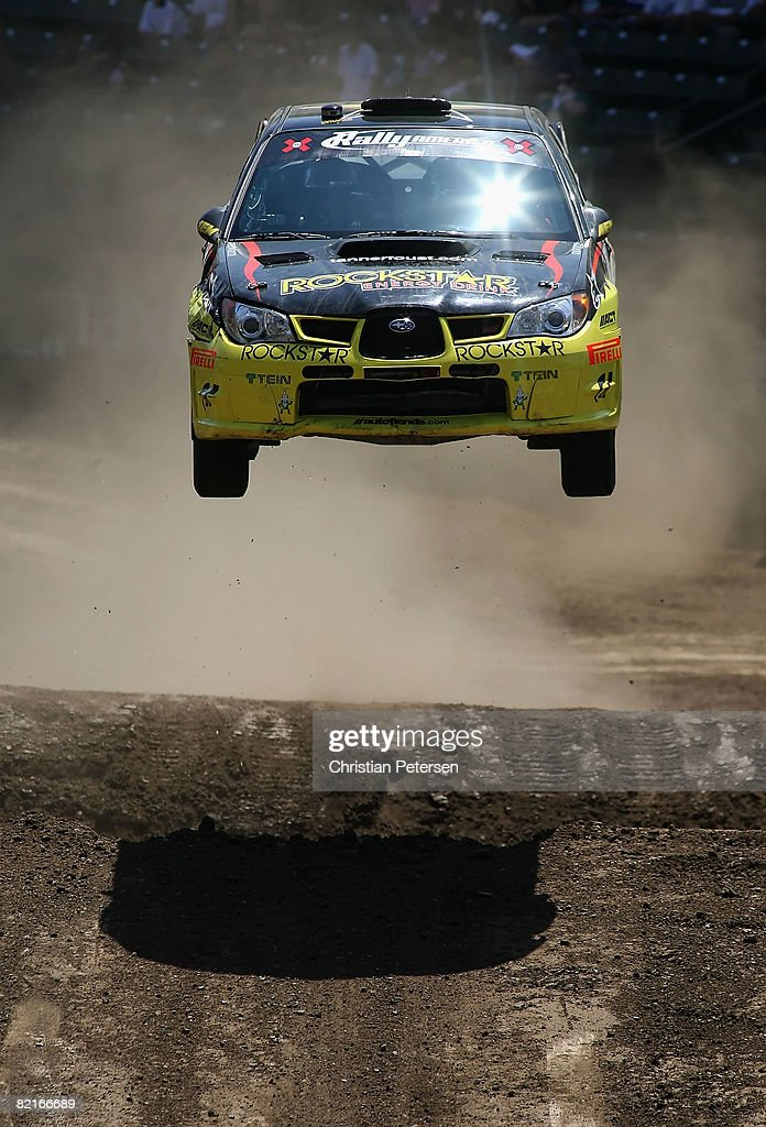 Drivers Tanner Foust and Christine Beavis take a jump in the Rally Car race during the summer X Games 14 at Home Depot Center on August 3, 2008 in Carson, California.