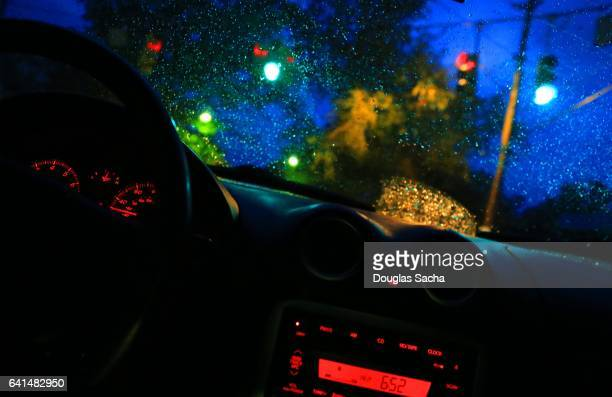 Drivers view in a moving car on a rainy night