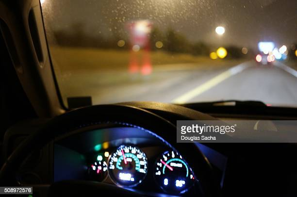 drivers viewpoint on a dark highway