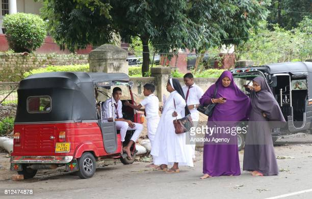 Drivers wait for their costumers near the 'tut tuk' which is using for transportation as a taxi in Colombo the capital of Sri Lanka on July 10 2017...