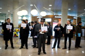Drivers wait for their Mobile World Congress 2013 attendees at the Barcelona El Prat Airport on February 24 2013 in Barcelona Spain Airport...