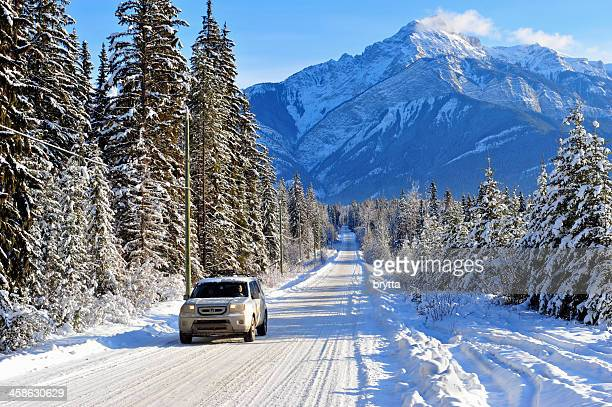 Driving a four-wheel car in Rocky Mountains near Golden, Canada