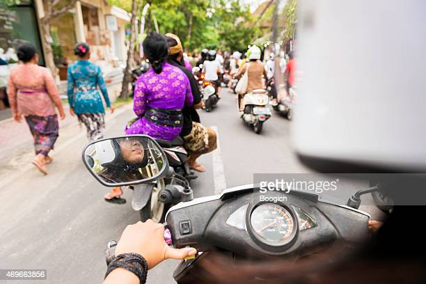 Driving a Motorbike Scooter Through Ubud Bali Rush Hour Indonesia