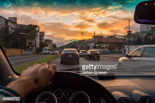 Driving at sunset. View from the driver angle,car focusinside : Stock Photo