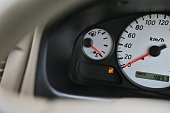 Driving car with digital oil gasoline level sign on the panel dashboard indicates that oil fuel is running low.