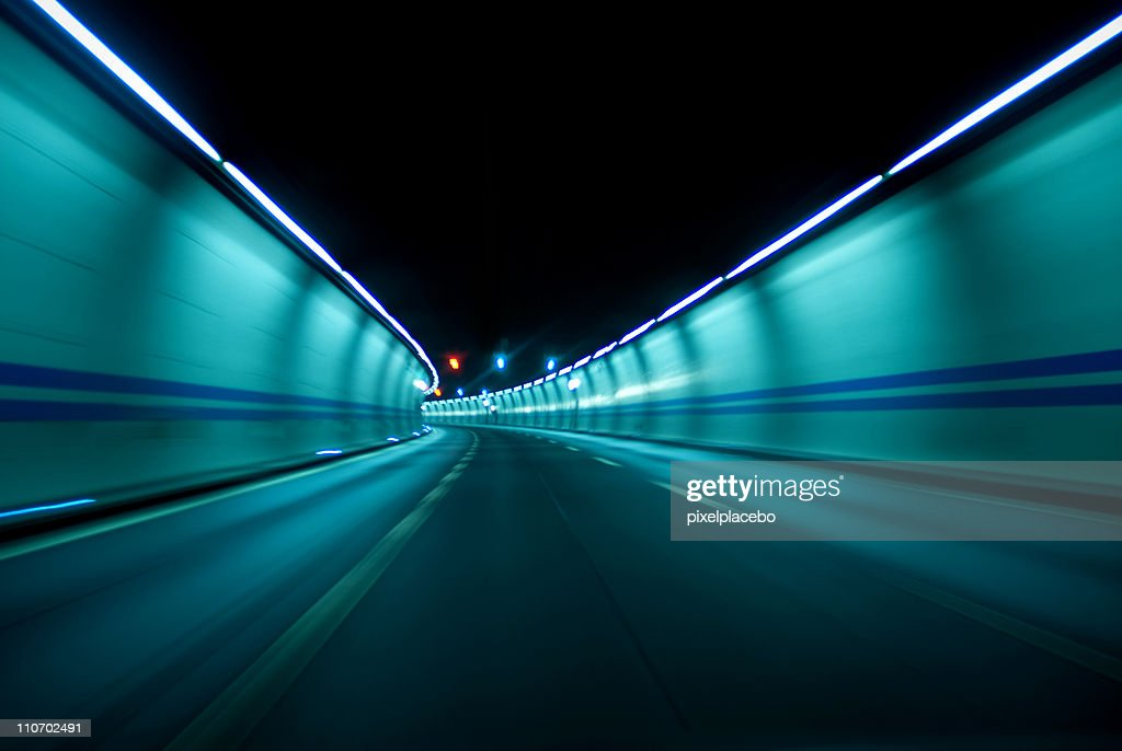 Driving fast inside tunnel : Stock Photo