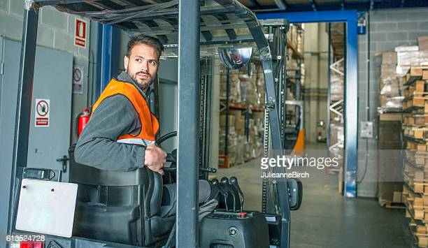 Driving fork lift trucks in warehouse