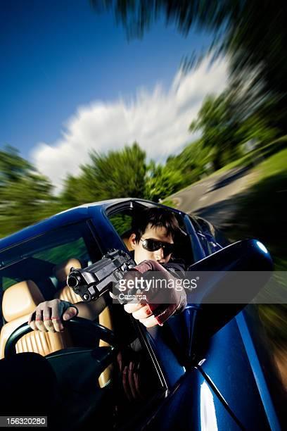 Driving gun fight